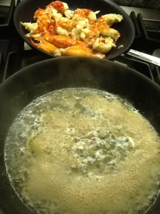 Lobster juice steaming and lobster meat in pan