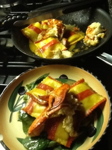 Lobster ravioli plated and pan on stovetop