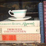 tea cup on cookbooks