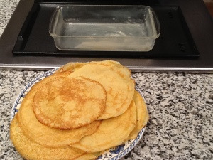 crepes ready for rolling buttered baking dish