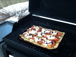 pizza grilling with snow