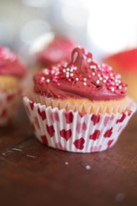 Red frosting cupcake close up-SusieE